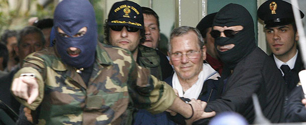 FILE-In-this-Tuesday-April-11-2006-file-photo-Mafia-boss-Bernardo-Provenzano-is-escorted-by-hooded-police-officers-as-he-enters-a-Police-building-in-downtown-Palermo-Italy.-AP-PhotoLuca-Bruno-File_Giuseppe_Ursino_blog